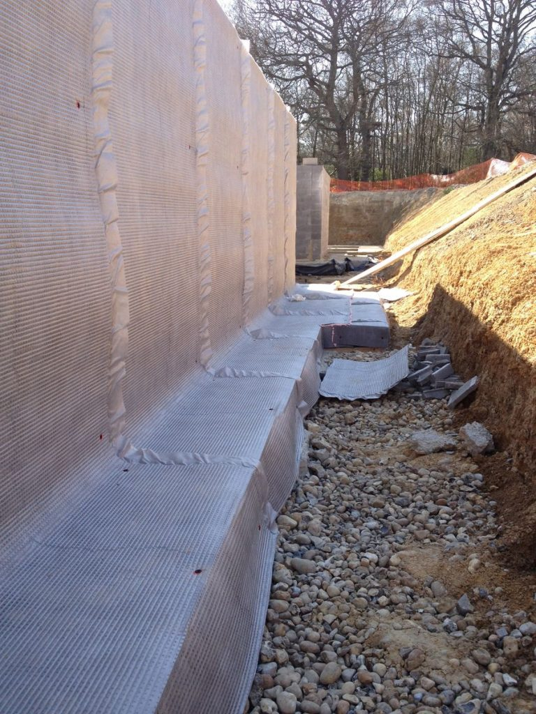 Application of Newton Drainage Membrane externally to a wall