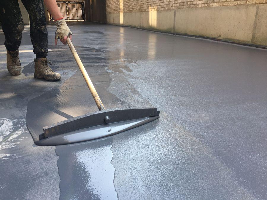 Application of high build epoxy floor coating to a floor