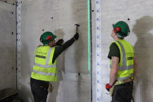 Installing Newton cavity drain membrane to vault walls