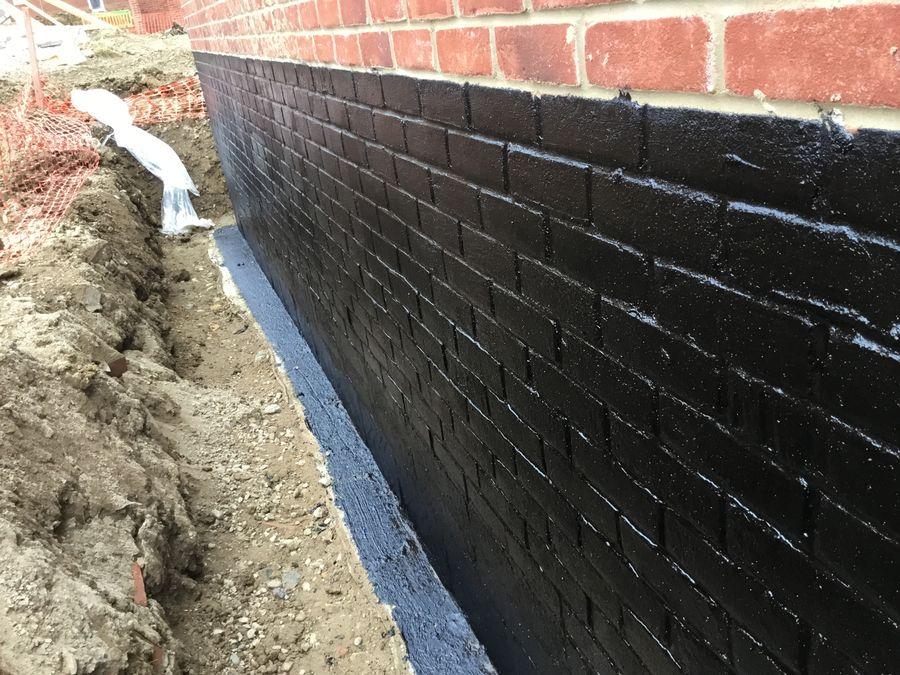 Rubber waterproofing membrane applied to brickwork