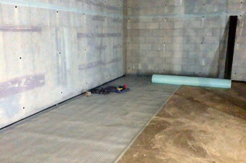 Newton 508 cavity drain membrane applied to walls and floors